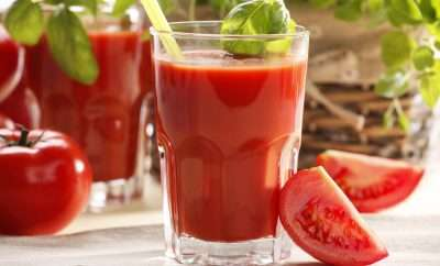 Glasses of tomato juice and celery sticks