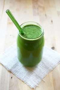 Green Juice in a glass and a straw