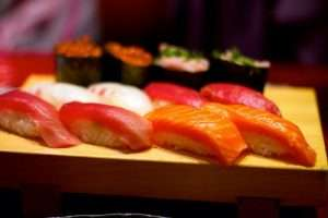 variety of shushi in a wooden board