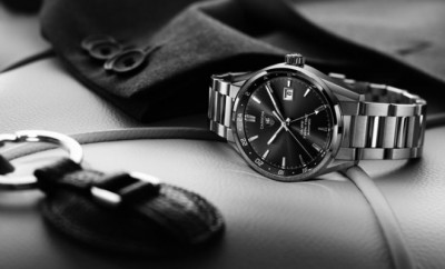 Black and white picture of a designer watches and car keys on a
