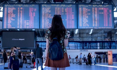 Woman looking at the airport boarding times
