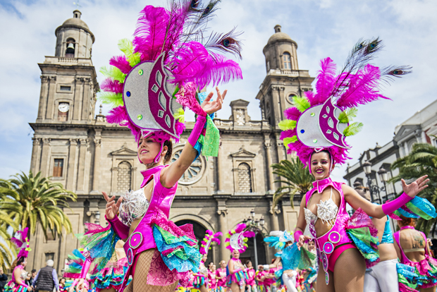 Carnivals parade with women in pink outfits