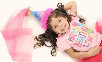 3 year girl dressed in pink top and pink tutu with a fairy hat