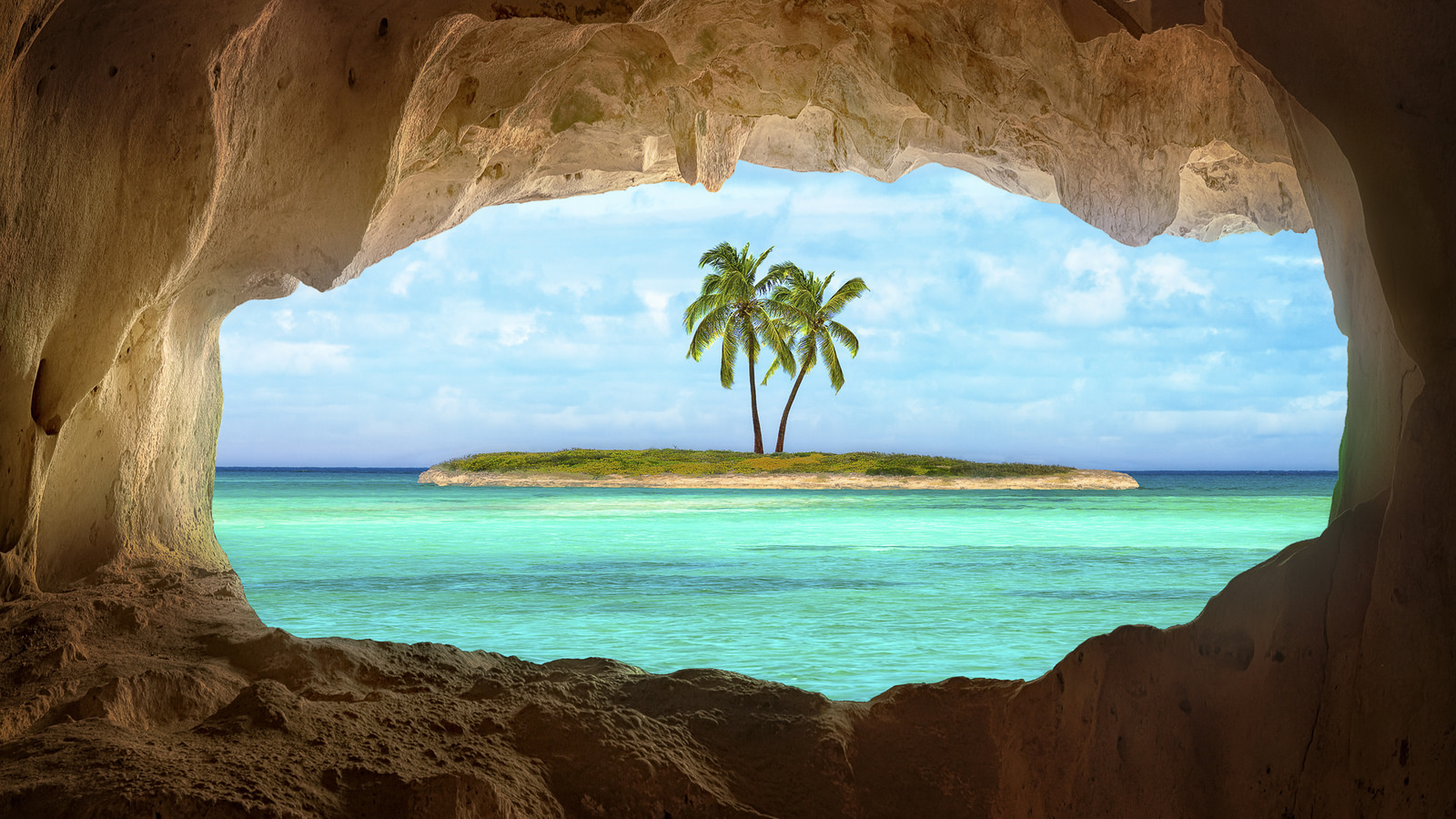Tropical island seen through a hole in rock formation