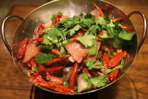 Wok dish with red chillis