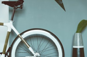 Pic of back of a bicycle in against a green wall