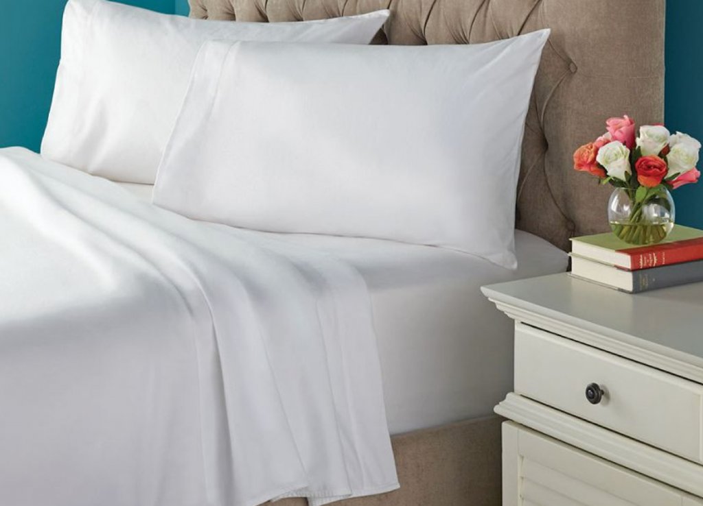 Bed with crisp white sheets and white pillows