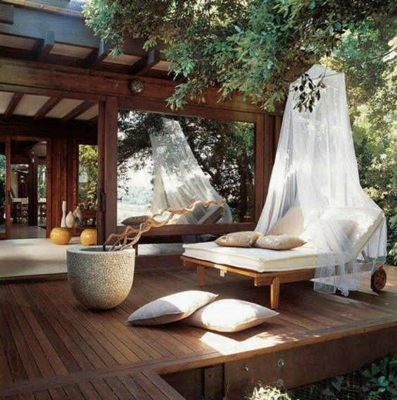 outdoor zen decor with curtains, wooden deck, pots and cushions