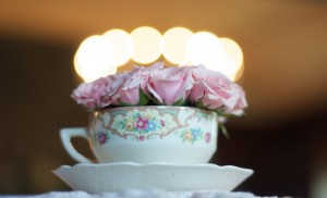 Old china with a bunch of short stem pink roses