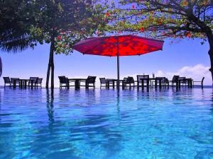 Bright red sun umbrella at the beach