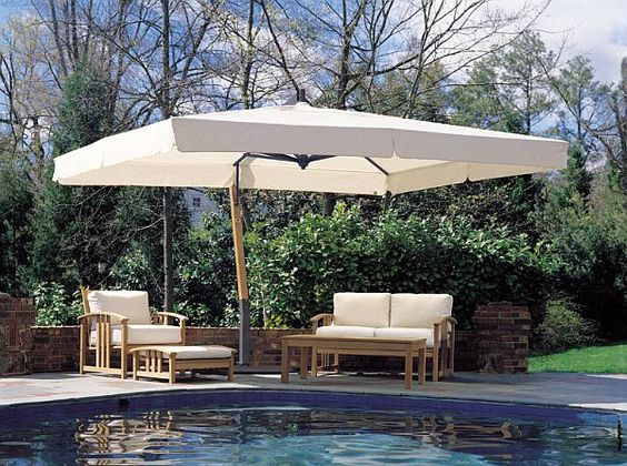 outdoor cantilever umbrella by a pool