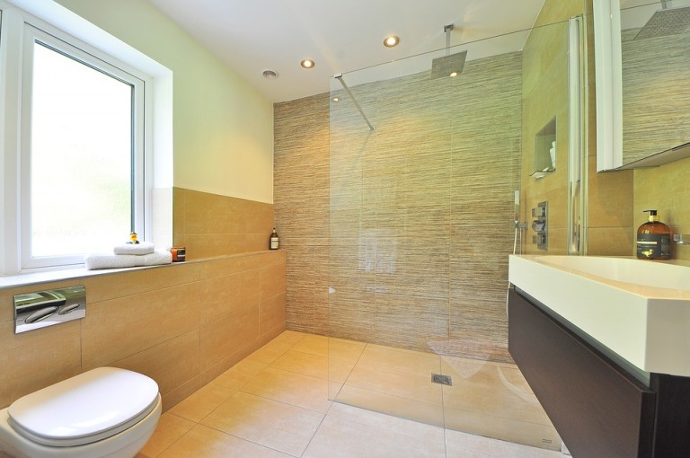 A bathroom with a glass shower