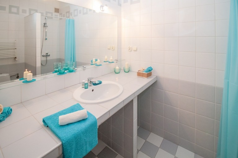 White bathrooms, with light blue towels