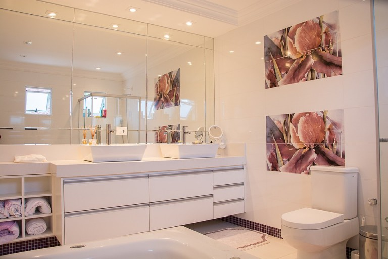White bathroom lit up appearing big