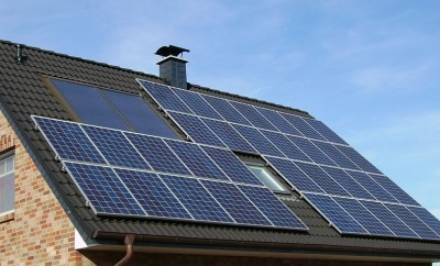 solar panels in a brick house roof
