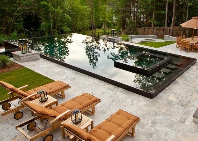 Stunning Backyard with splash pool and sunchairs