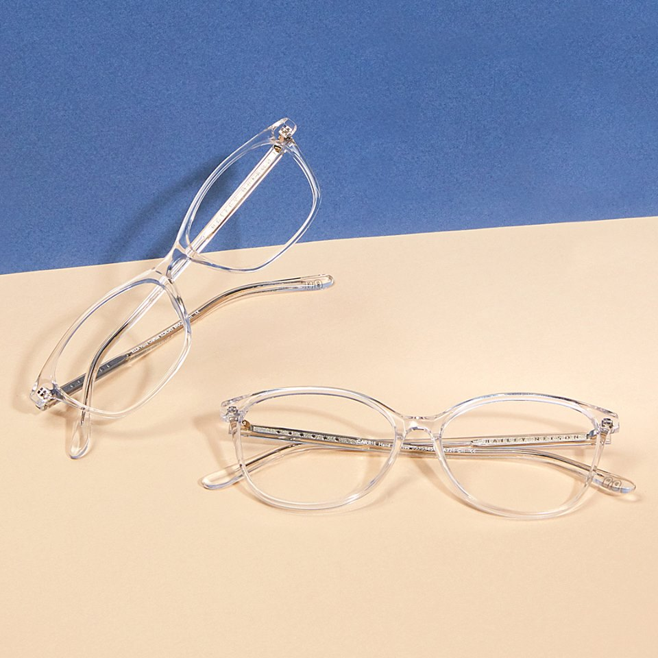 two plastic see through framed reading glasses.