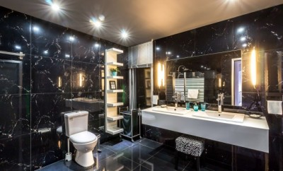 large modern bathroom with black wall to wall granite