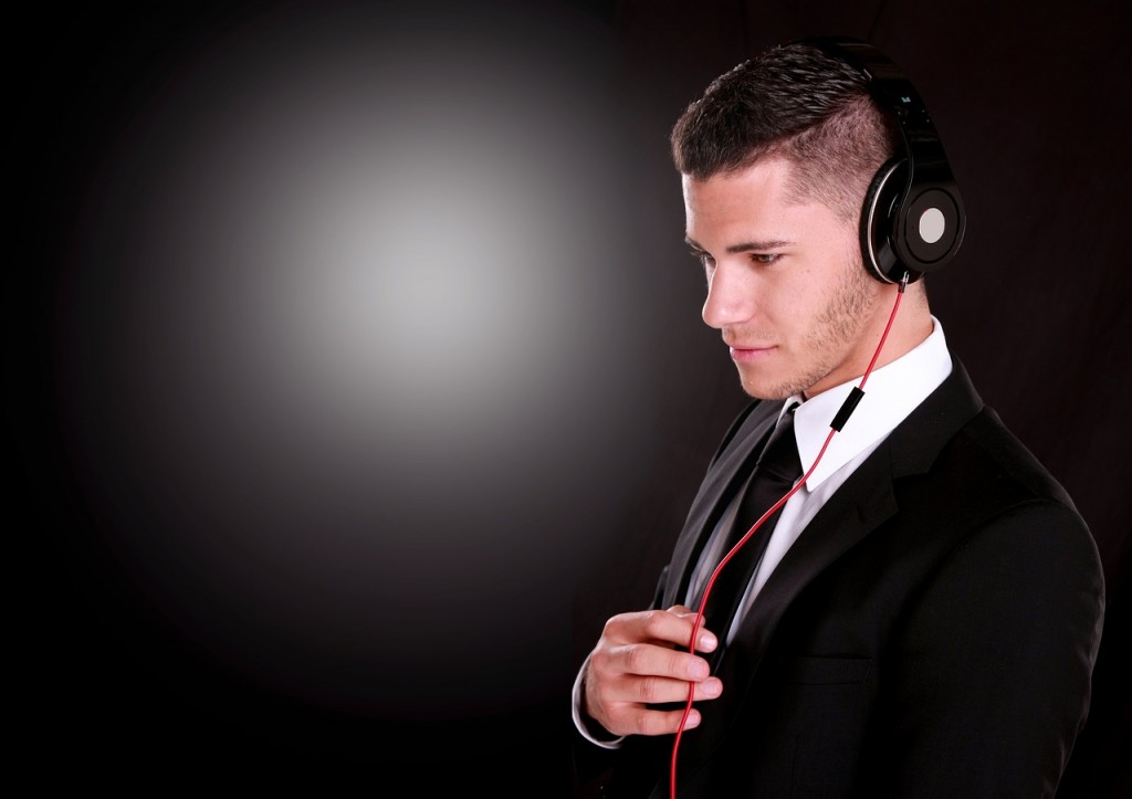 Young man with headphones and blue navy suit