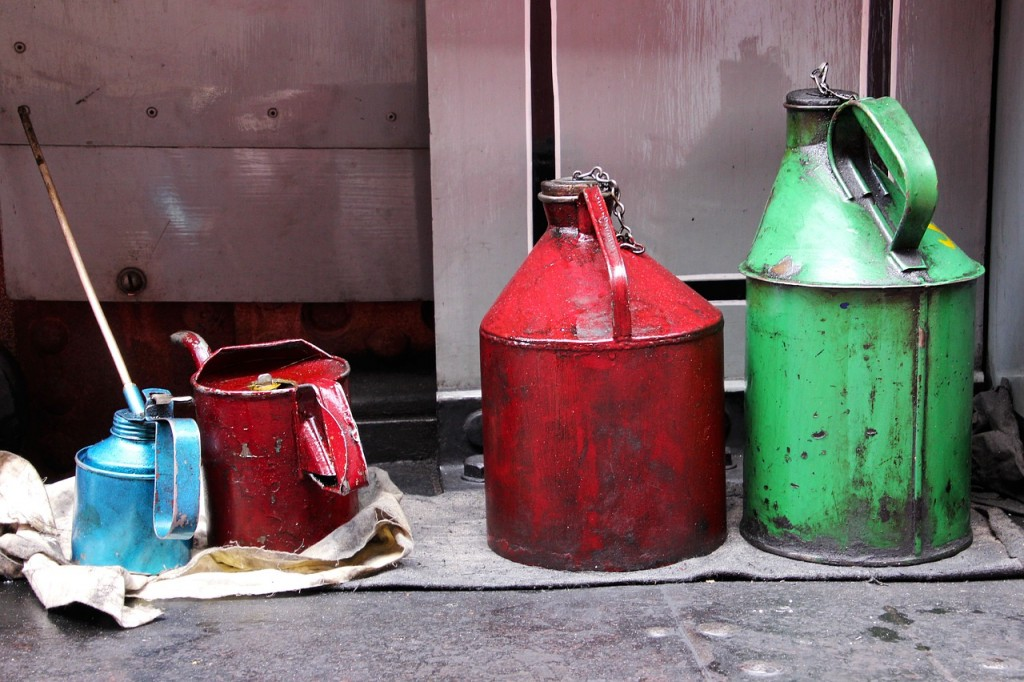 red and green grease containers