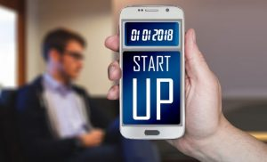 smartphone screen with with print saying 'startup'