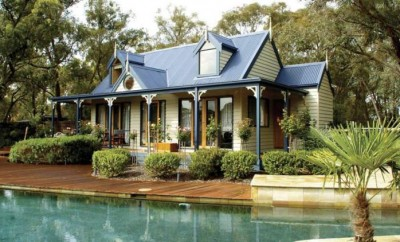 Granny flat with shrubs and a pool