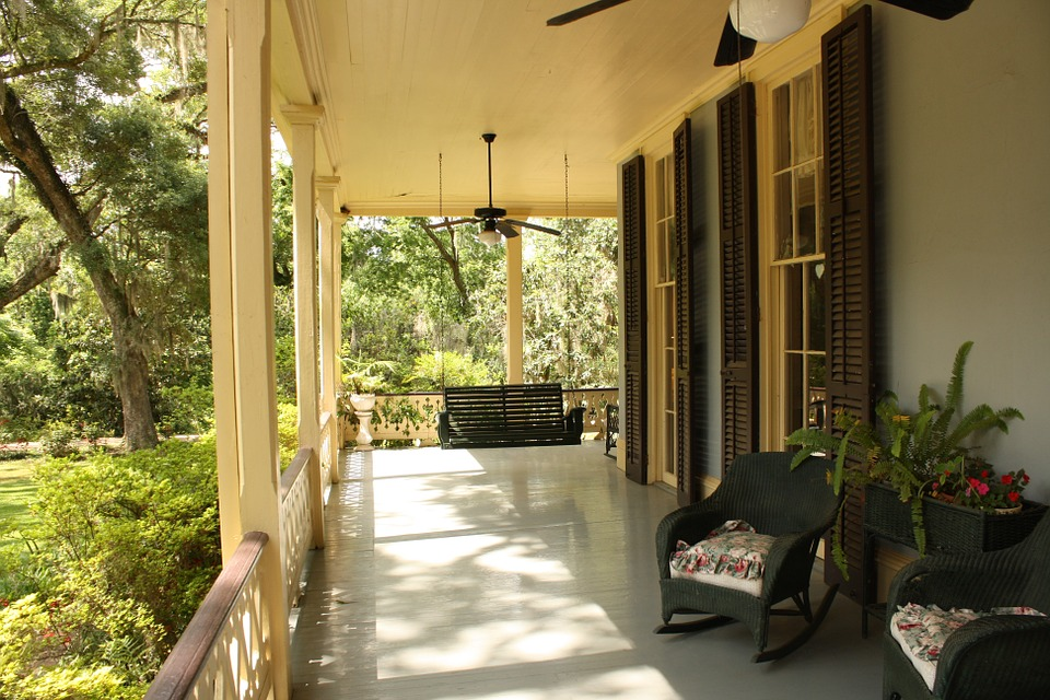 Long view of a verandah with swing and rock chair