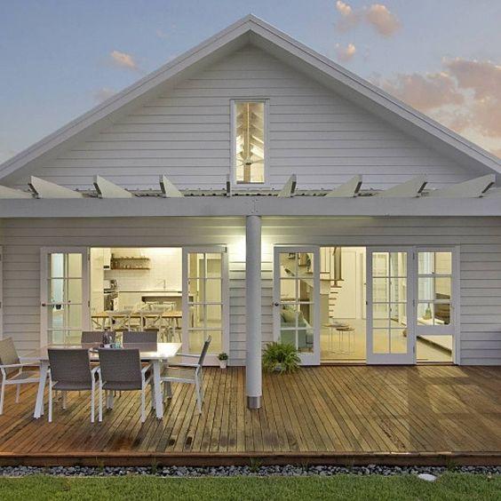 White granny flat with a verandah