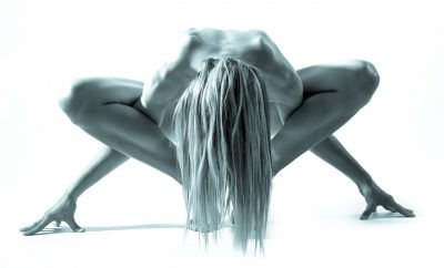 Woman in a naked yoga pose