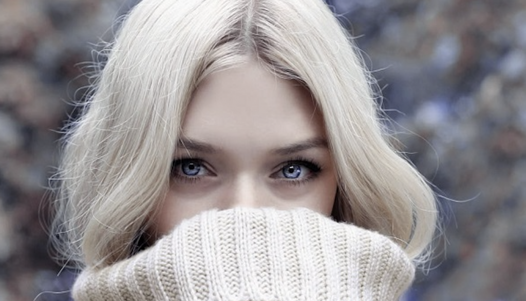 blond girls with blue eyes and long turtle neck hiding lips