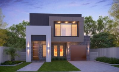 Modern two story home with outside house lights on
