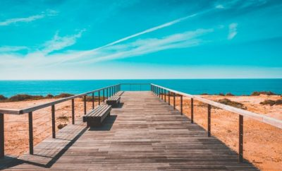 long pathway facing the blue skies and ocean
