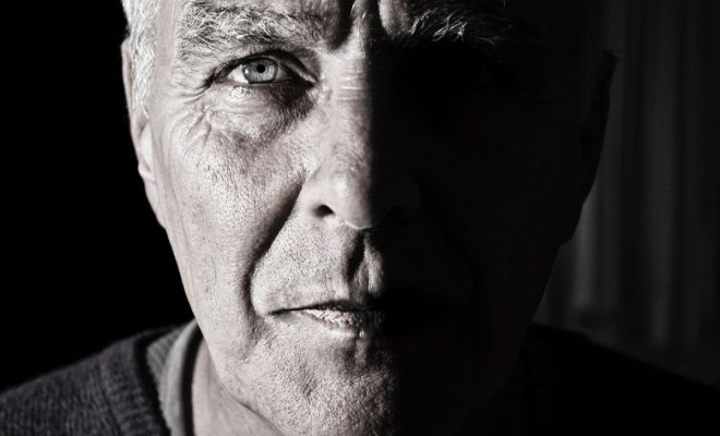 close up of an older man staring right into the camera