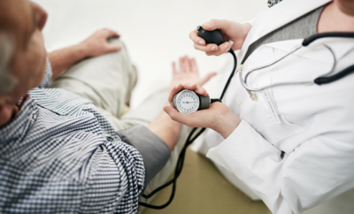 doctor taking patient blood pressure