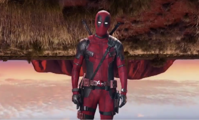 Deadpool with Ayers Rock upside down behind him