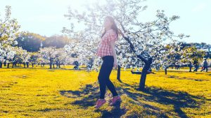 pregnant lady with checkered shirt walking in nature