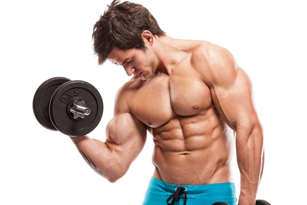 Ripped young man lifting weights