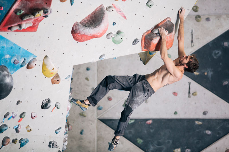 Alternative workouts to try this summer - Indoor climbing in the bouldering gym wall.