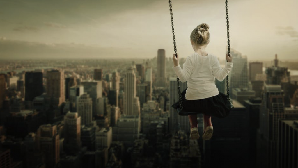 Girl on swing with city views
