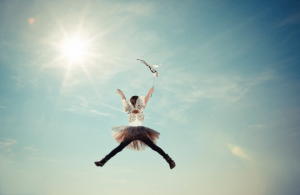 Girl in tooto skirt jumping high