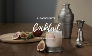 Cocktail shaker, a glass with a drink in it and figs on a brown table