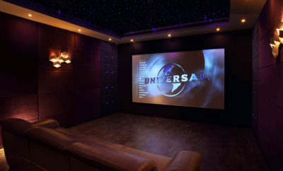 home theatre , with big TZ screen and brown leather lounges