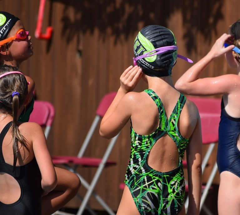 back of a swimmer girls in one piece green bathers