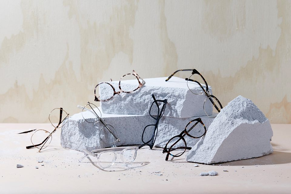many reading glasses on display in stone