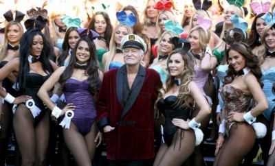 Hugh Hefner surrounded by playboy bunnies