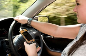 woman drive and looking at the phone