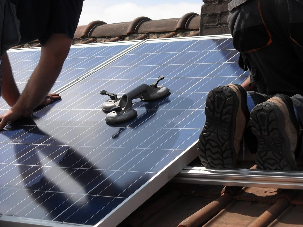 How to Plan a Solar Electric System for Your Home -laying down solar panels