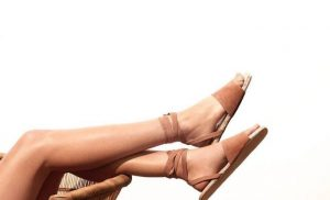 ladies legs with emphasis on sandals