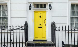White house with yellow entrance door