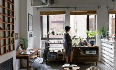 Woman in casual wear, working from her home office